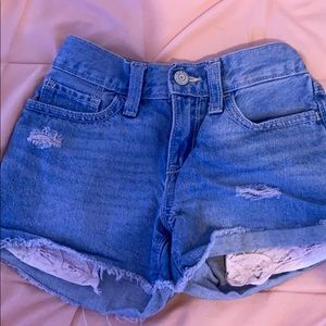 Blue jean shorts with light pink lace